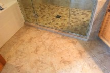 Rich tile flooring warms up the remodeled bathrooms.