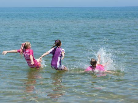 Kids play in Lake MI